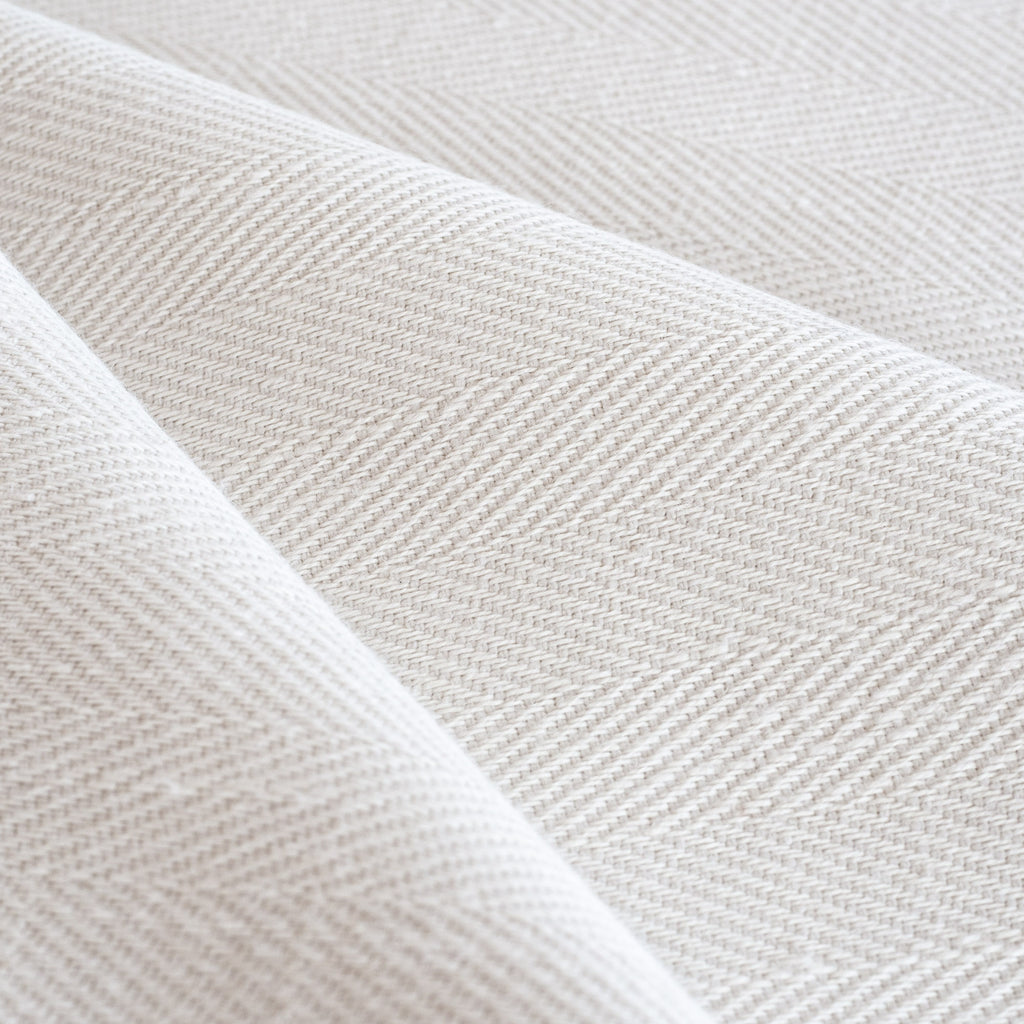 Harris White, a soft white herringbone pattern performance upholstery fabric from Tonic Living
