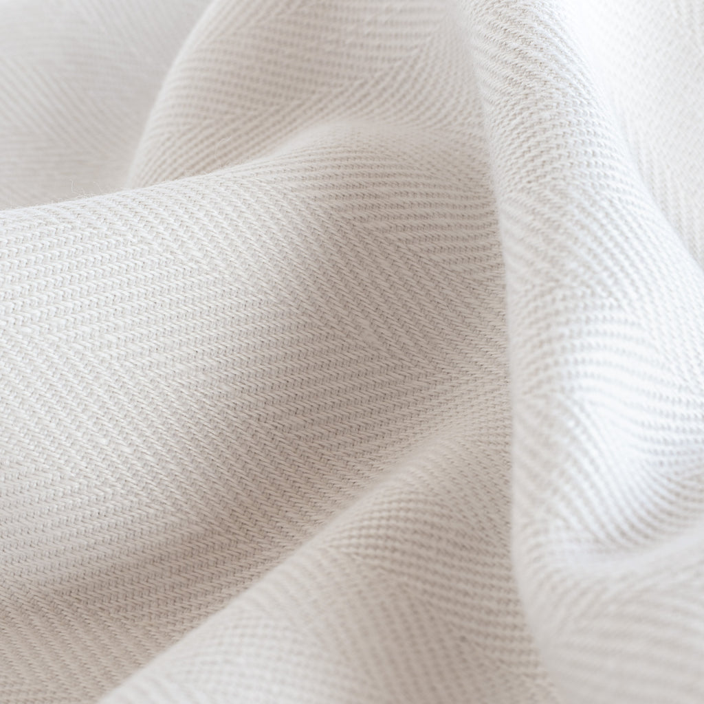 Harris White, a soft white herringbone pattern performance upholstery fabric