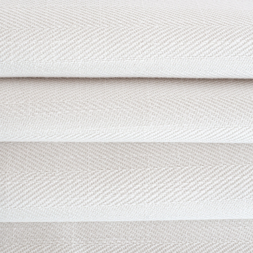 Harris White, a soft white herringbone pattern performance upholstery fabric : close up view