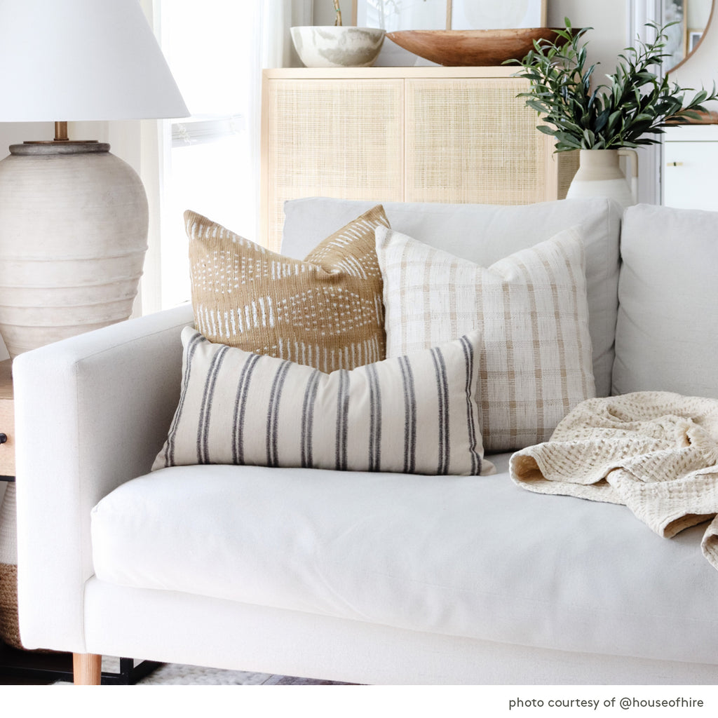 combination of decorative pillows on a cream sofa