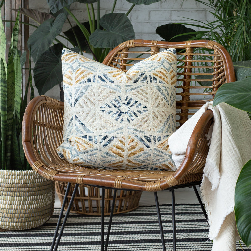 indoor outdoor vignette: Isla laguna pillow shown on a chair