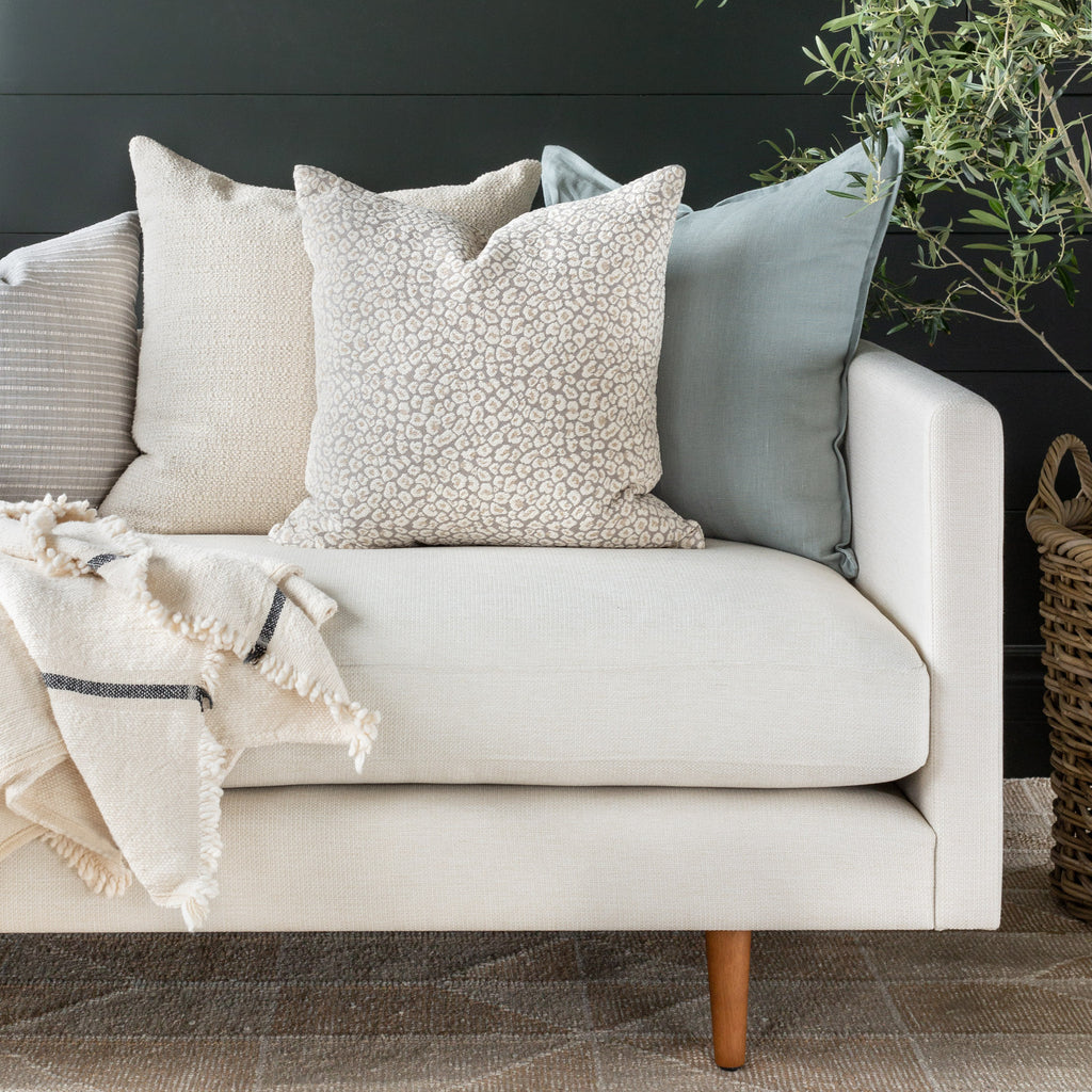Jackie spots pillow combination: Shown with Milly Vanilla and Tuscany Lake pillows on a cream sofa