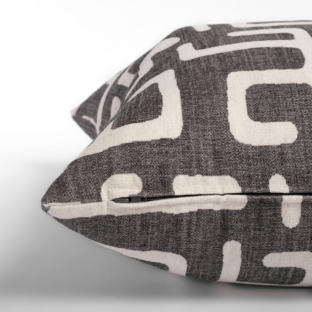 charcoal grey and beige abstract print pillow zipper detail