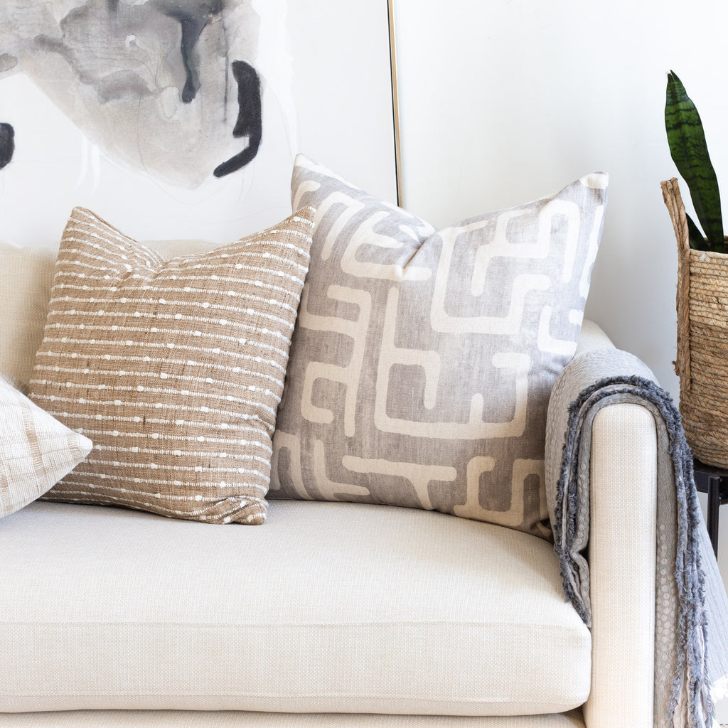 Cream sofa pillow combination: Karru silver and Arren Burlap pillows