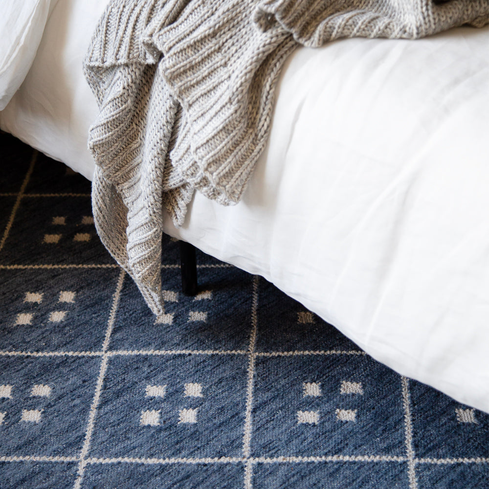 Kota, a blue and cream diamond pattern rug at Tonic Living