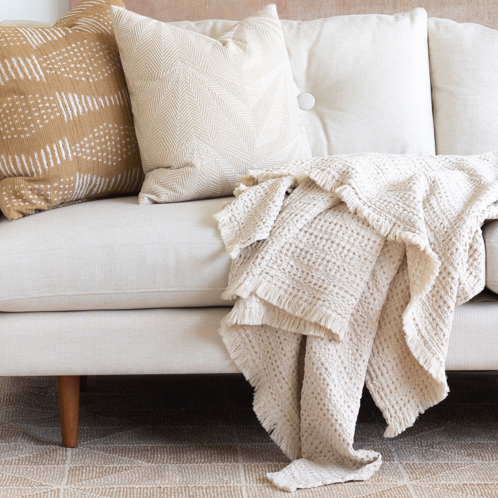 Neutral decor: Lena waffle textured throw blanket and pillows on sofa