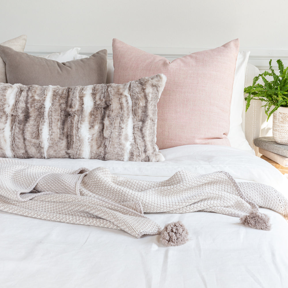 Neutral and pink bed pillow combo from Tonic Living