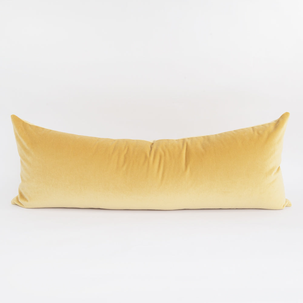 Mason Velvet Golden Hour Bolster, a yellow velvet bed pillow from Tonic Living