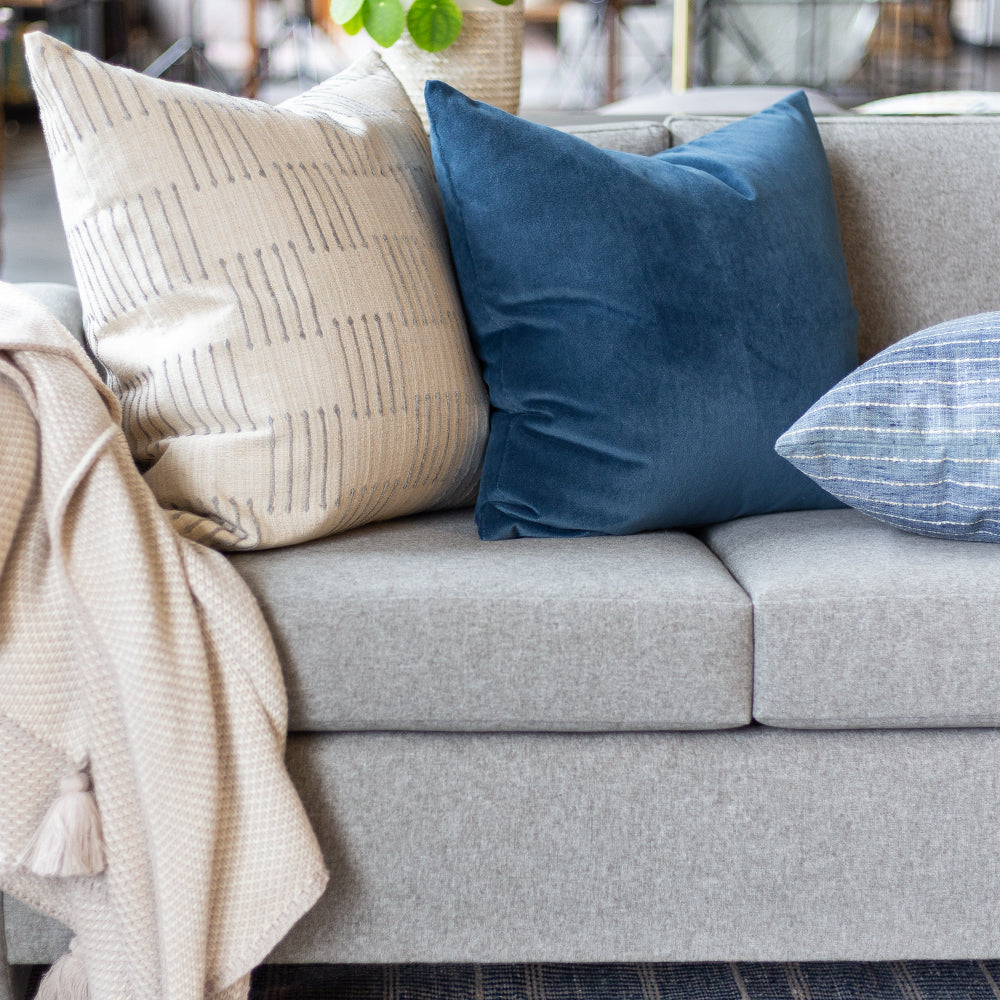 blue velvet and beige sofa pillow combination