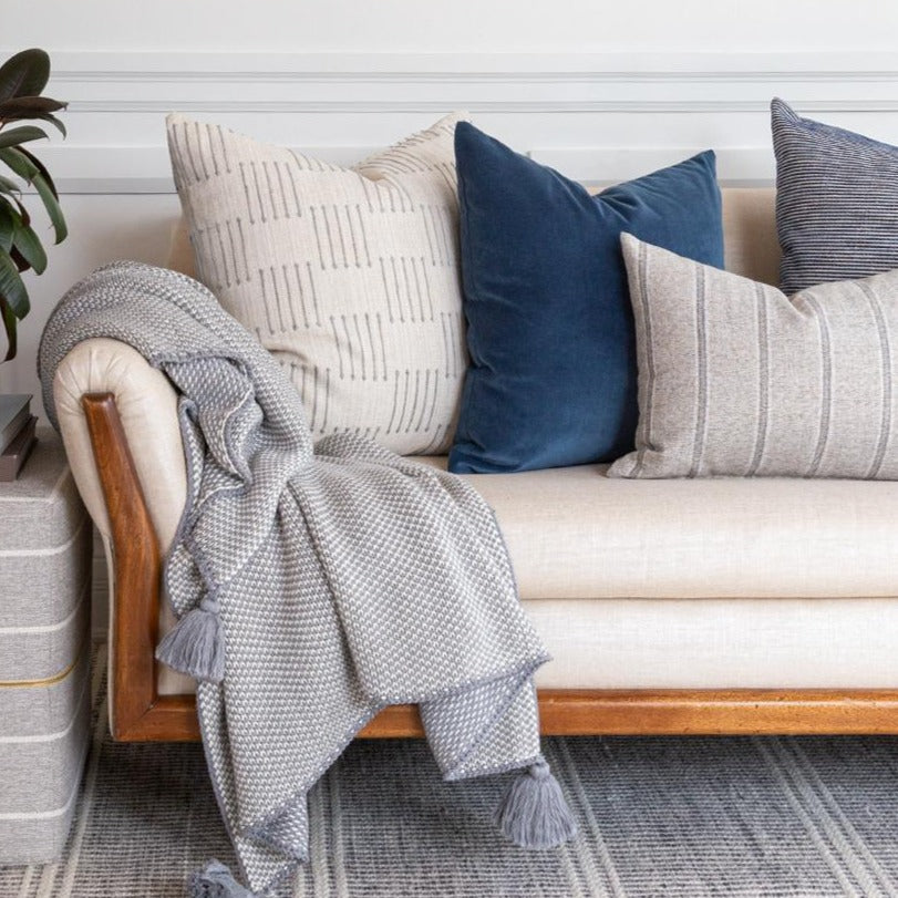 blue velvet and grey pillows and blanket combination