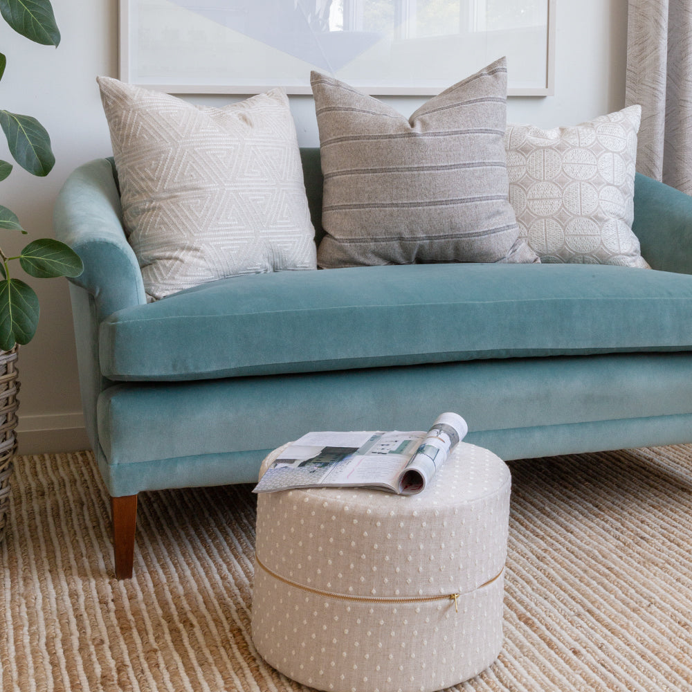 designer neutral pillows and mini ottoman