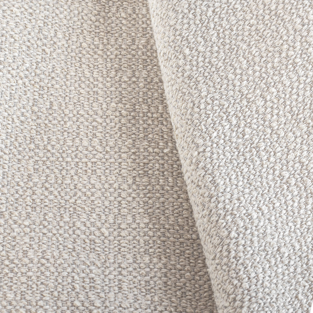 Milly Vanilla Cream, a sandy-beige upholstery fabric with a chunky weave from Tonic Living