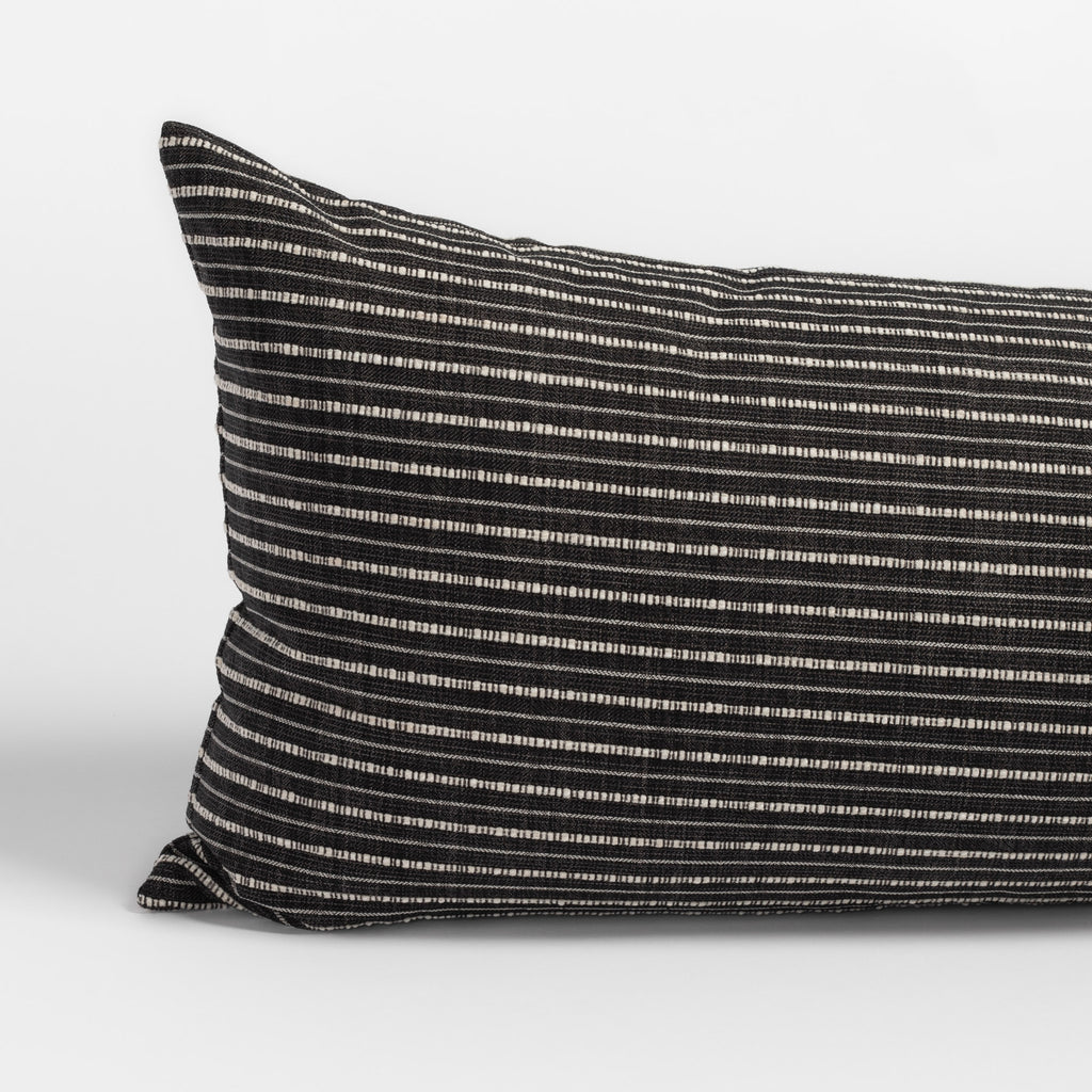 Misto charcoal bed bolster, a black and cream horizontal stripe extra long lumbar pillow : corner close up view