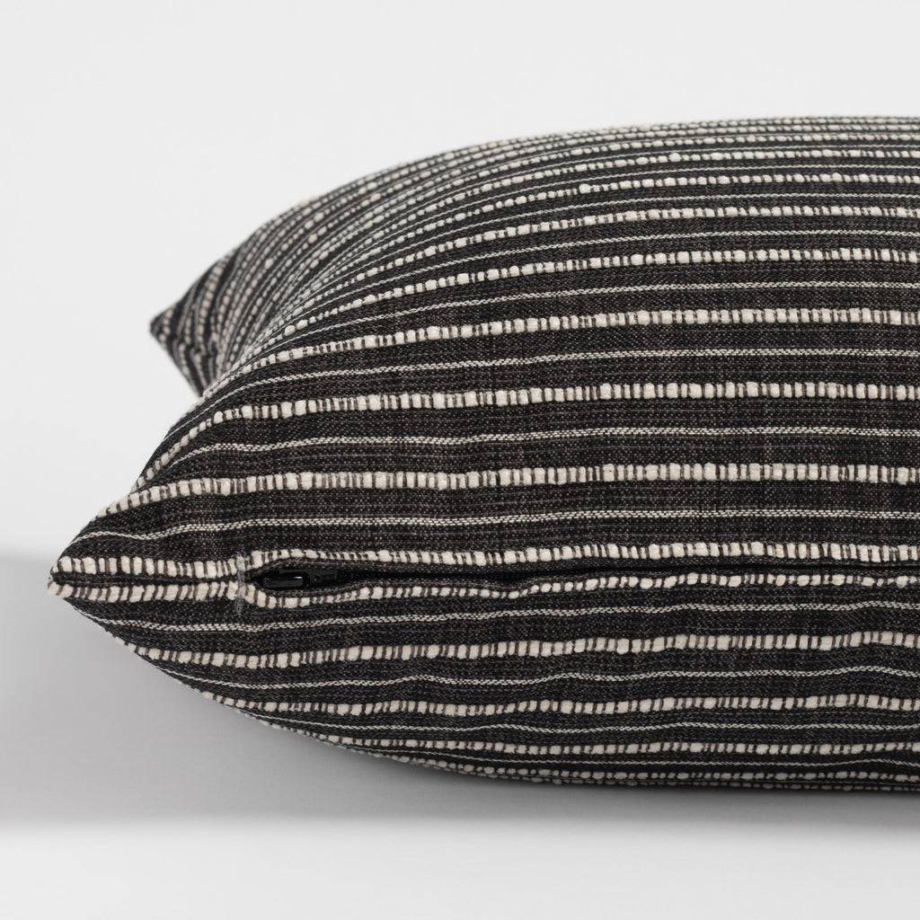Misto charcoal bed bolster, a black and cream horizontal stripe extra long lumbar pillow : zipper detail