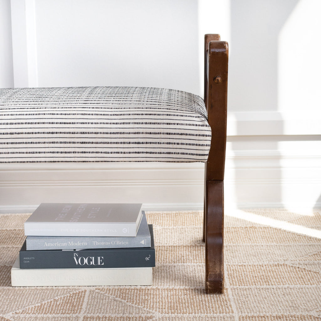 Misto stripe cream and black performance fabric shown on a bench cushion
