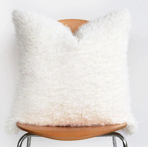 "Nordic Shag, Polar - The perfect shaggy white faux fur pillow in 22"" x 22""."