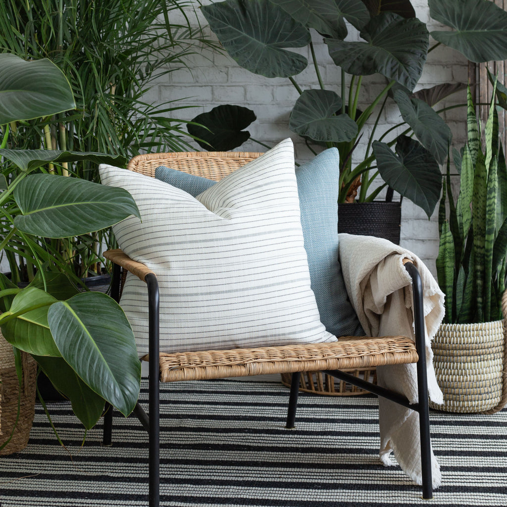 Indoor outdoor vignette: Olcott graphite and Ernesto blue pillows