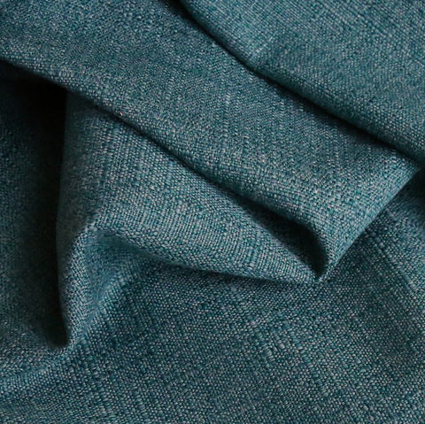 A solid teal upholstery fabric with a classic slubbed weave.