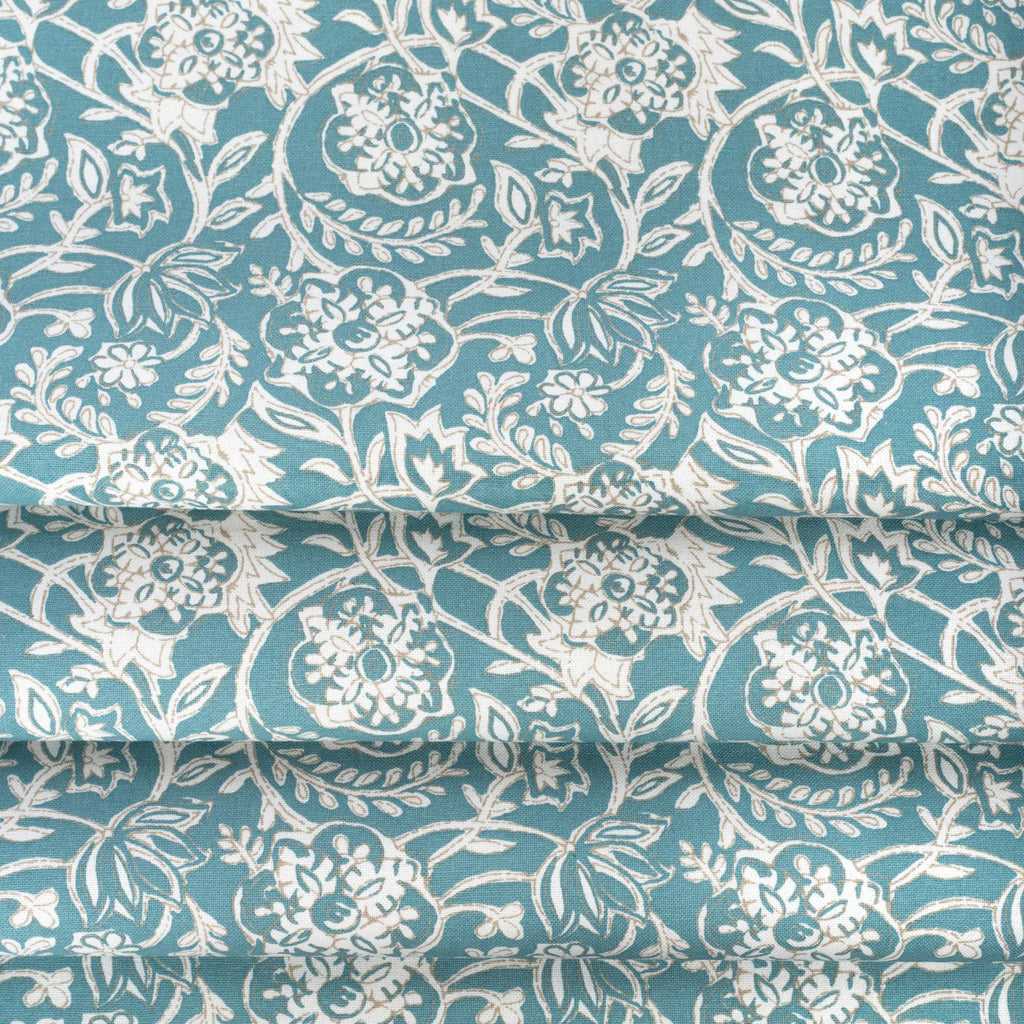 Padma Aqua, an aqua blue and cream tapestry block print pattern cotton fabric : close up view