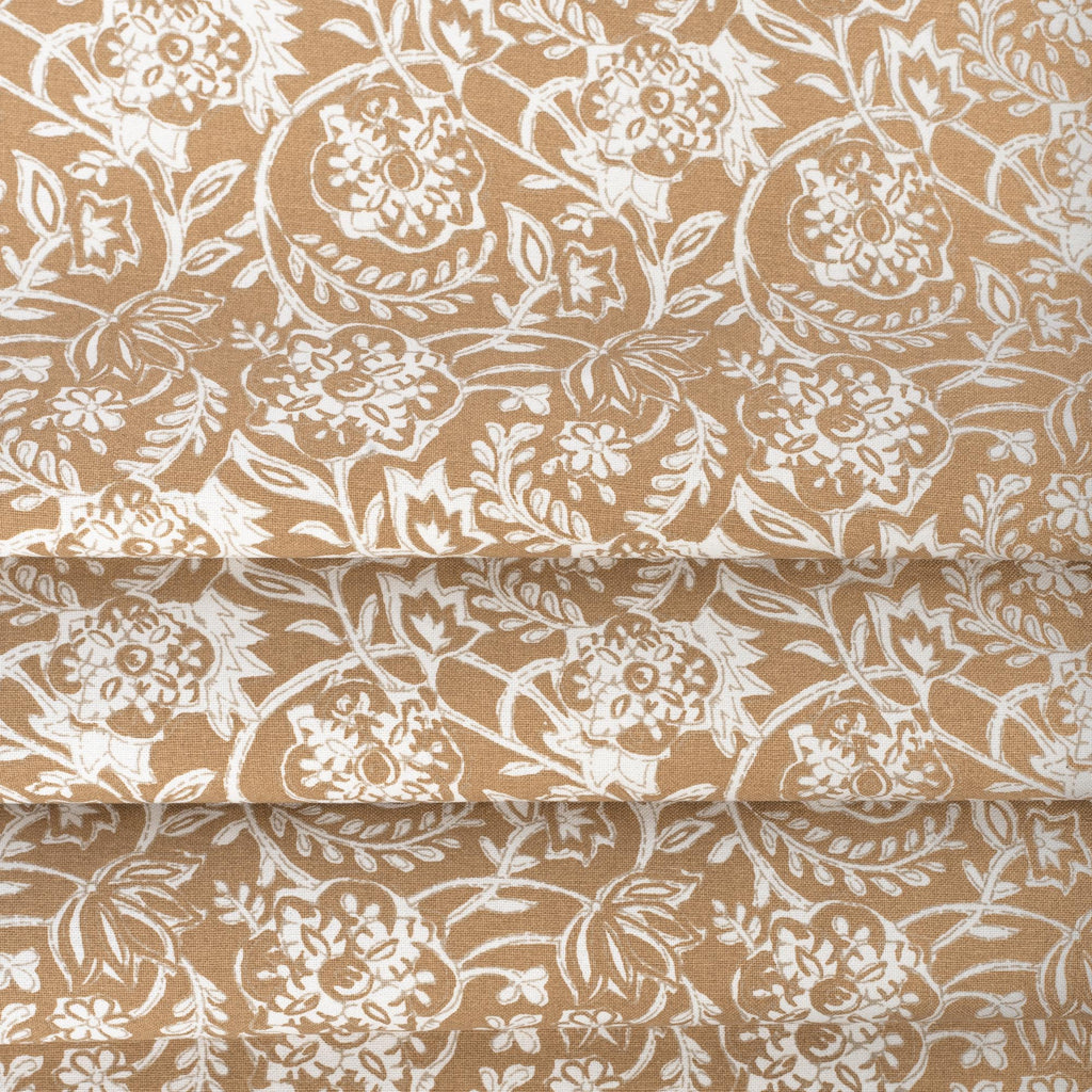 Padma Nutmeg, a caramel brown and cream tapestry block print pattern cotton fabric : close up view