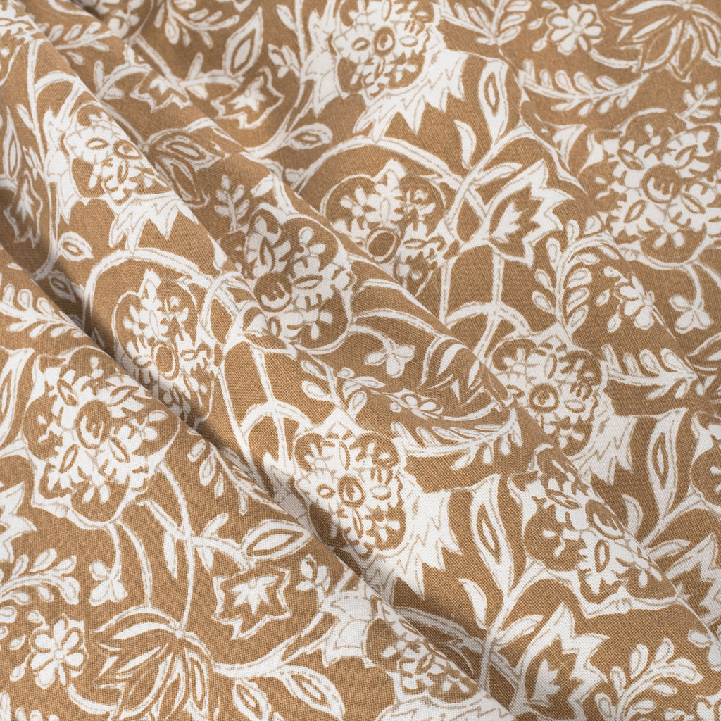 Padma Nutmeg, a caramel brown and cream tapestry block print pattern cotton fabric : detailed view