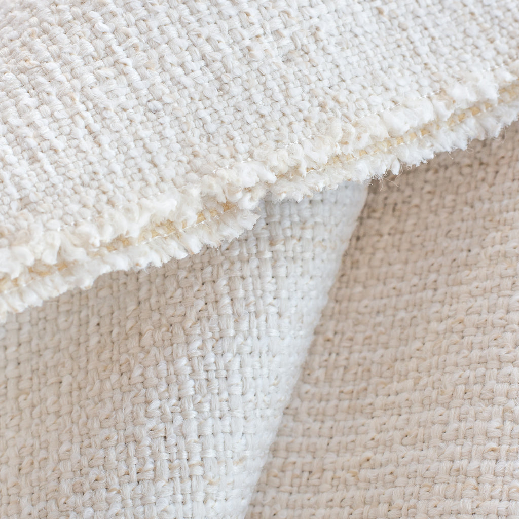 Preston Oyster indoor outdoor fabric, a light cream basket weave fabric: close up view