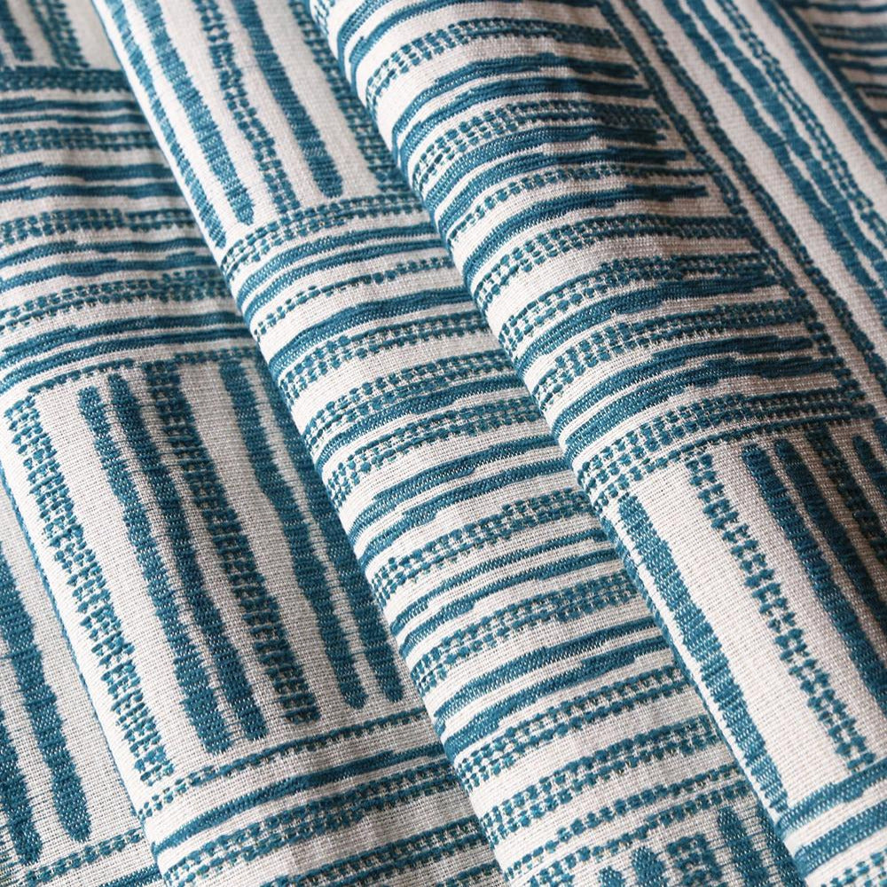 A cross hatched patterned fabric ingreen-blue and cream made of a heavier, woven jacquard. Justina Blakeney Home collection.