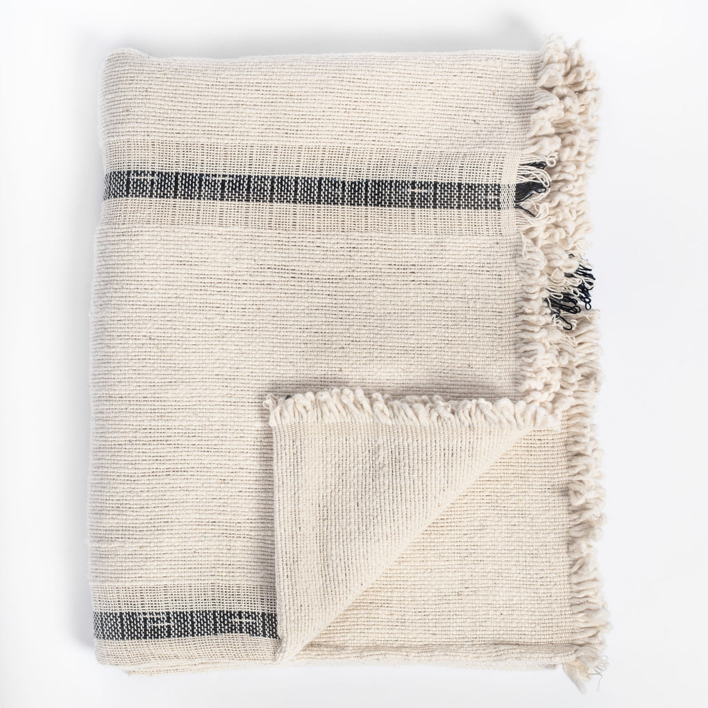 Rafael Cream, a cream with black stripe chunky weave cotton throw blanket from Tonic Living