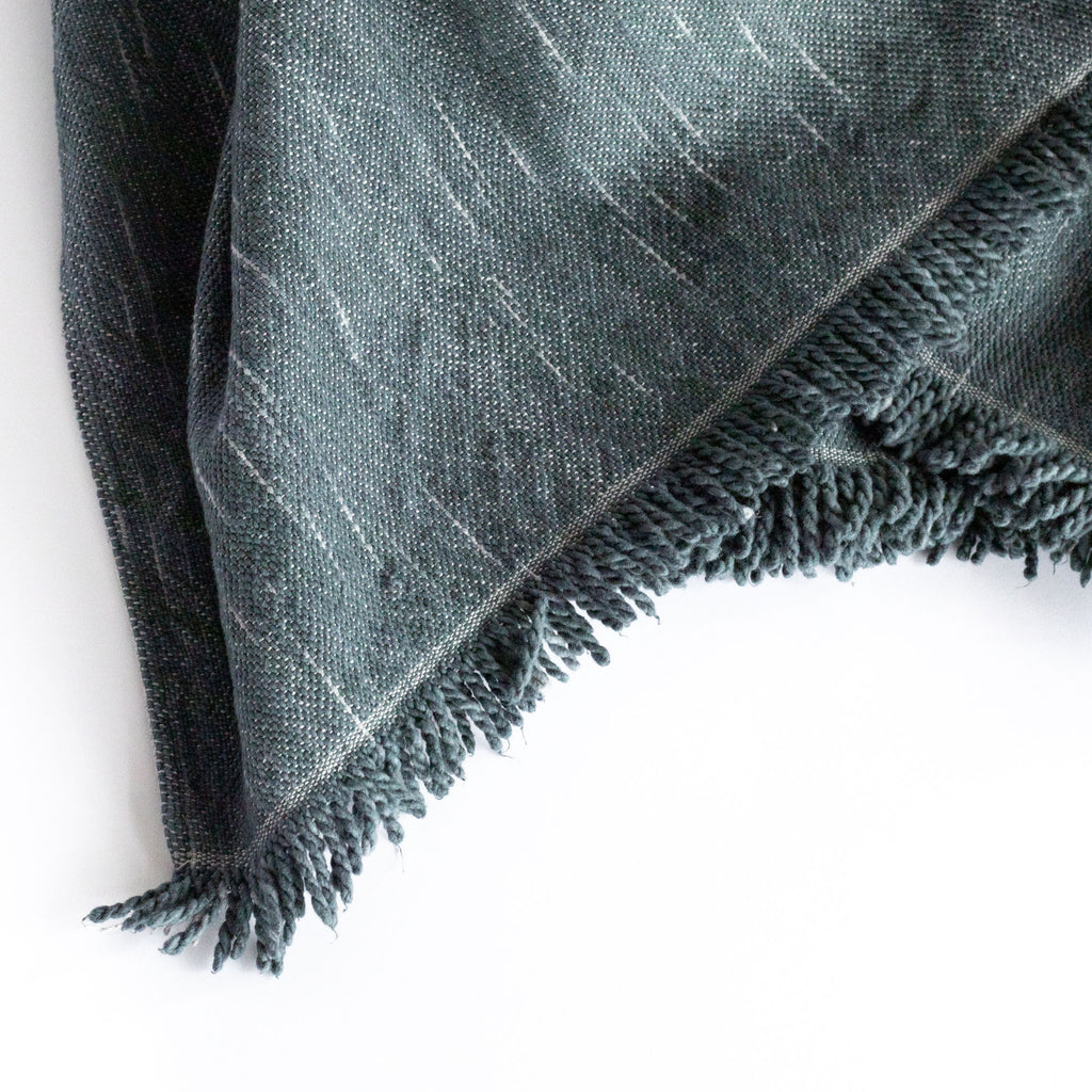 Rafael Stone Blue, a deep blue with cream slubs, chunky weave cotton throw blanket : close up view