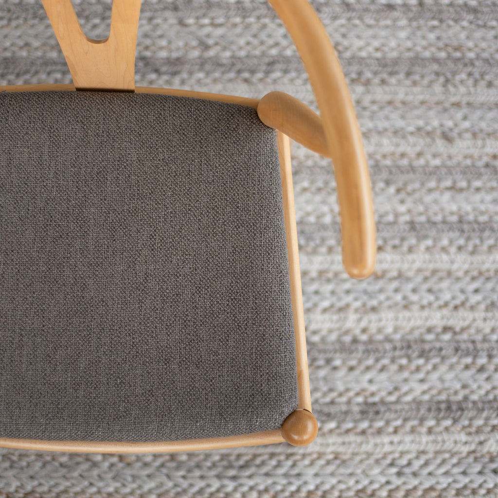 Ridgley bark brown performance fabric on a dining chair seat