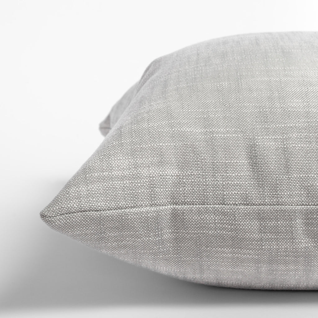 Ryder Zinc, a light grey indoor outdoor pillow: close up view