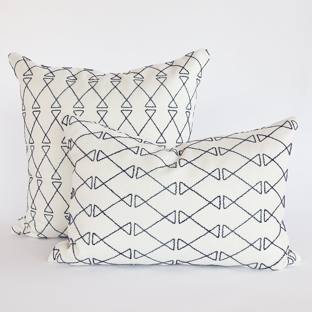 Santo indigo blue embroidery on ivory pillows from Tonic Living