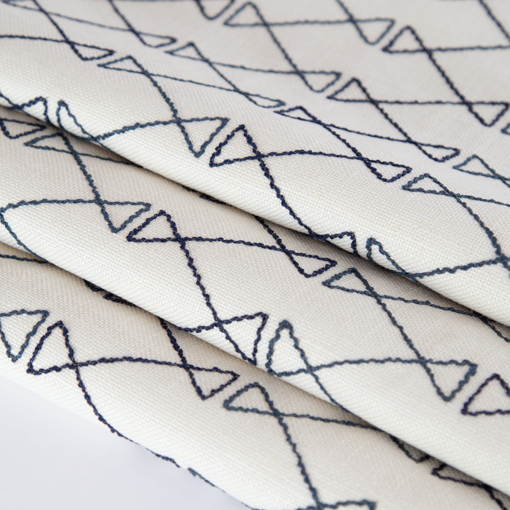 Santo blue graphic embroidery on cream fabric from Tonic Living