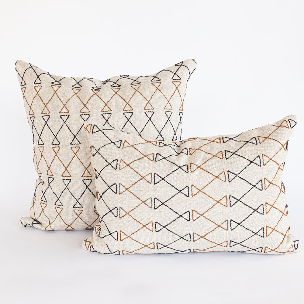 Santo natural, black and brown and graphic embroidery pillows from Tonic Living