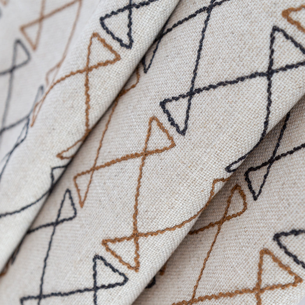 Santo black and brown graphic embroidery on natural fabric from Tonic Living