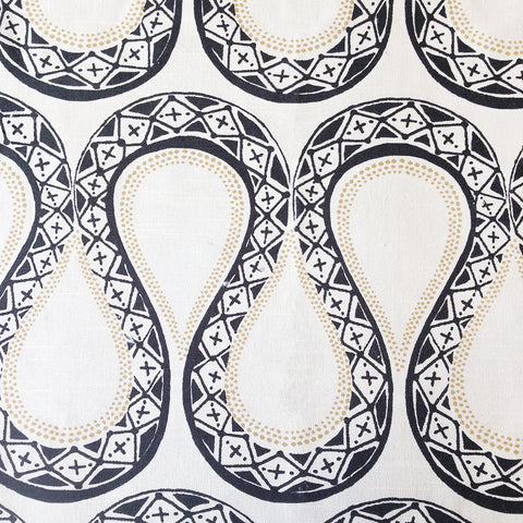 Sexy Serpentine, Inked Fabric - Tonic Living Genevieve Gorder snake inspired fabric in cream, black and pale yellow-gold.