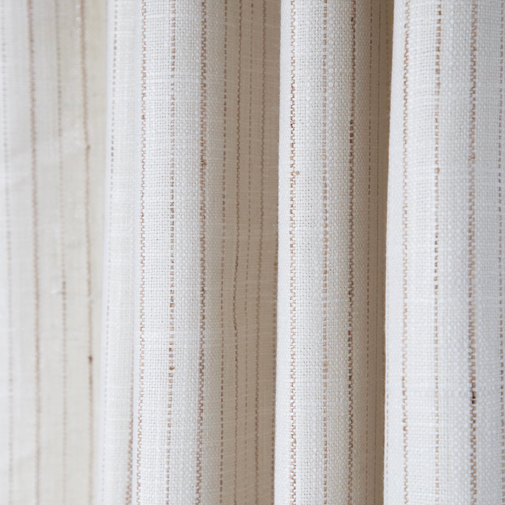 A natural, cream striped upholstery fabric with a thin, wicker tan coloured stripe.