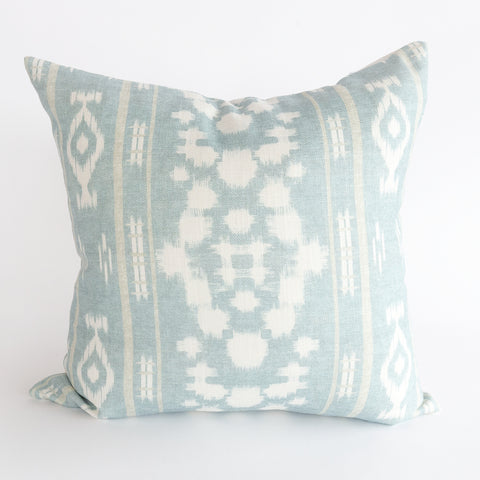 Skye light blue and white ikat pillow from Tonic Living with reversible white striped back
