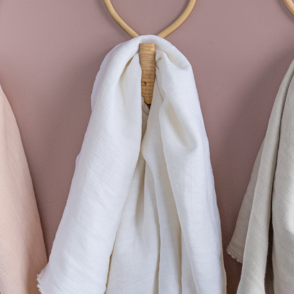 white linen fabric draped on a wall hook