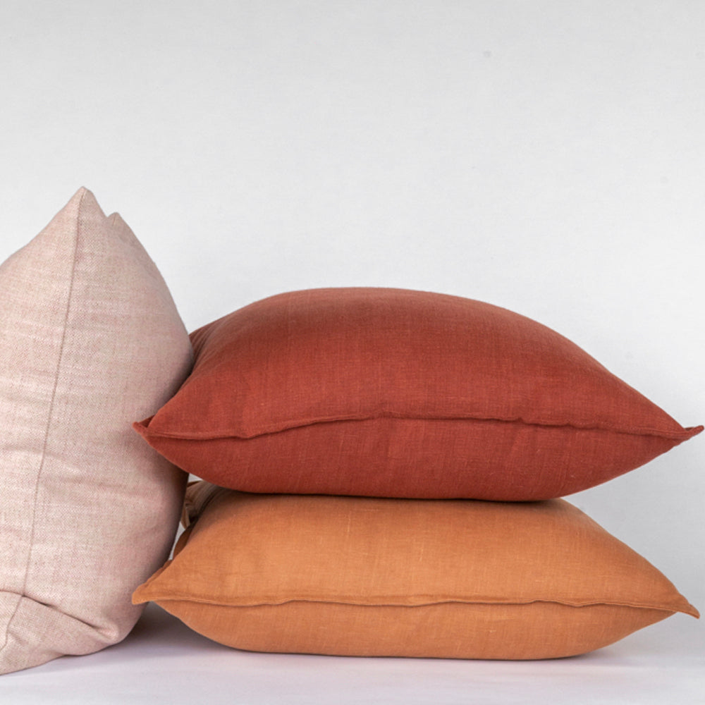 Tuscany linen Sumac rust red and Sedona burnt orange pillows from Tonic Living
