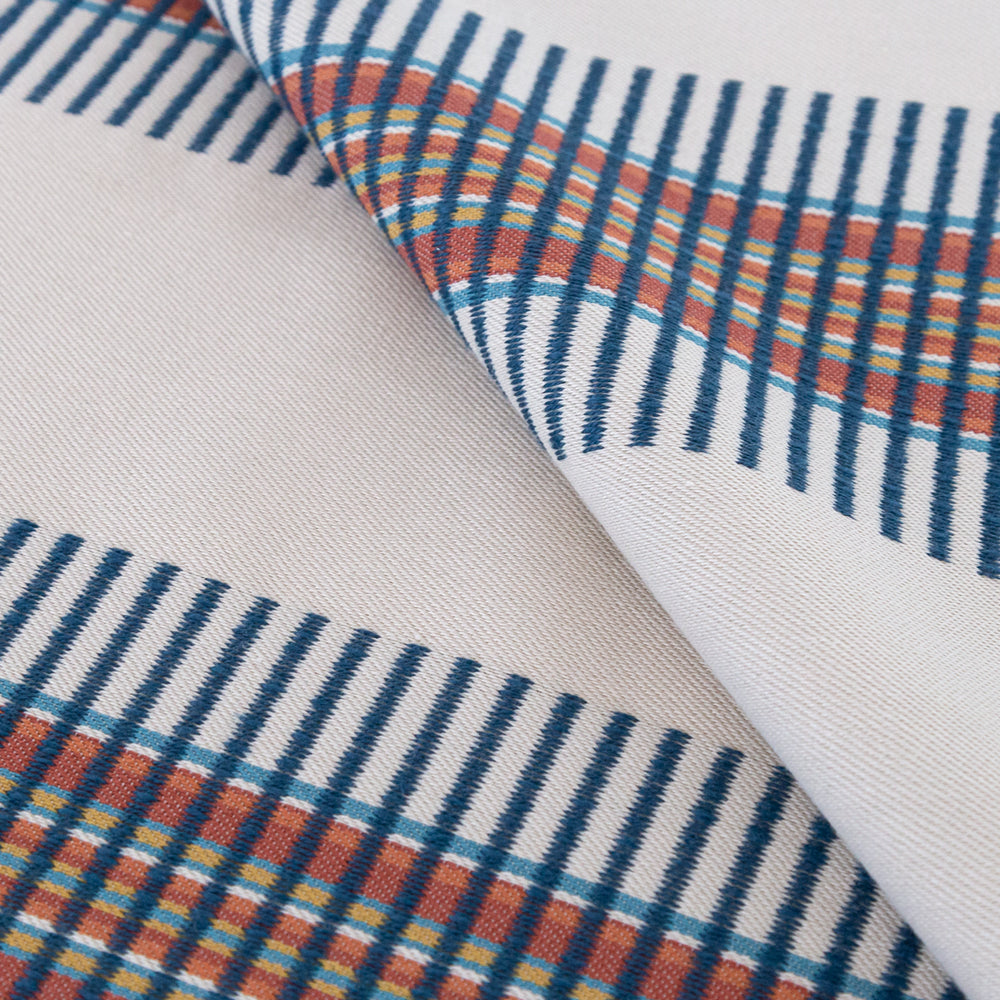 Zanzibar Regatta indoor outdoor fabric, a bold navy and rust woven stripe on a light taupe fabric from Tonic Living