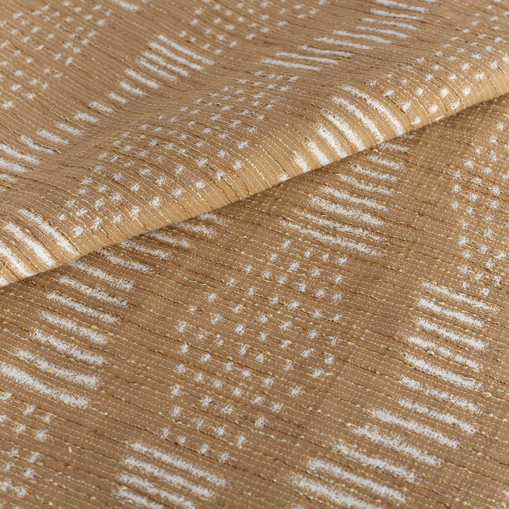 Zipporah Cork, a camel colour upholstery fabric with cream dot dash motifs from Tonic Living