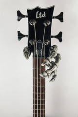 skeleton hand guitar hook holding ltd bass guitar.