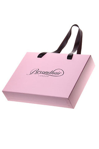 Pink Beyond Hair branded gift bag.