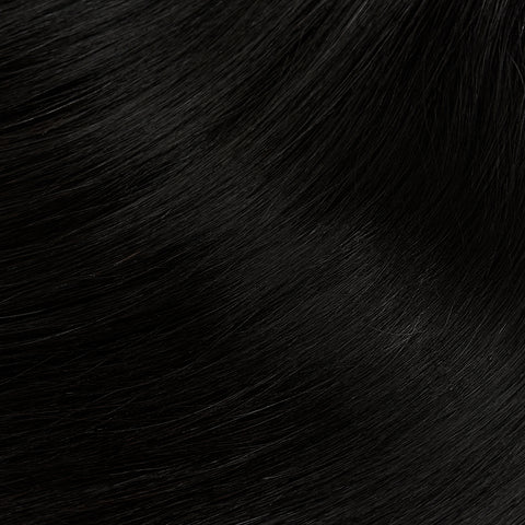 close up of black straight brazilian hair extensions