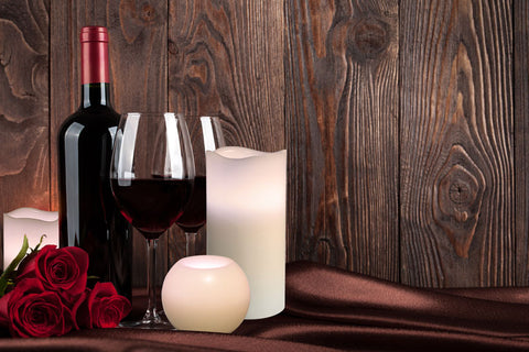 Pillar Candles and wine with roses