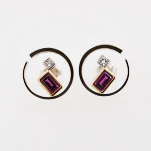 Gold earrings with garnets and diamonds