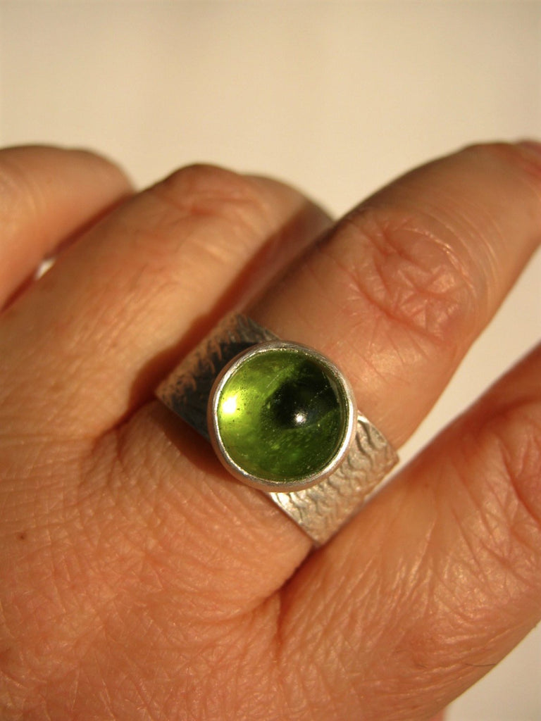 Peridot Ring on Wide Band