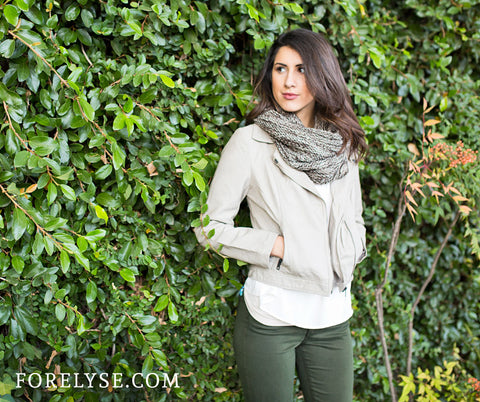 Beige leather jacket paired with olive green pants