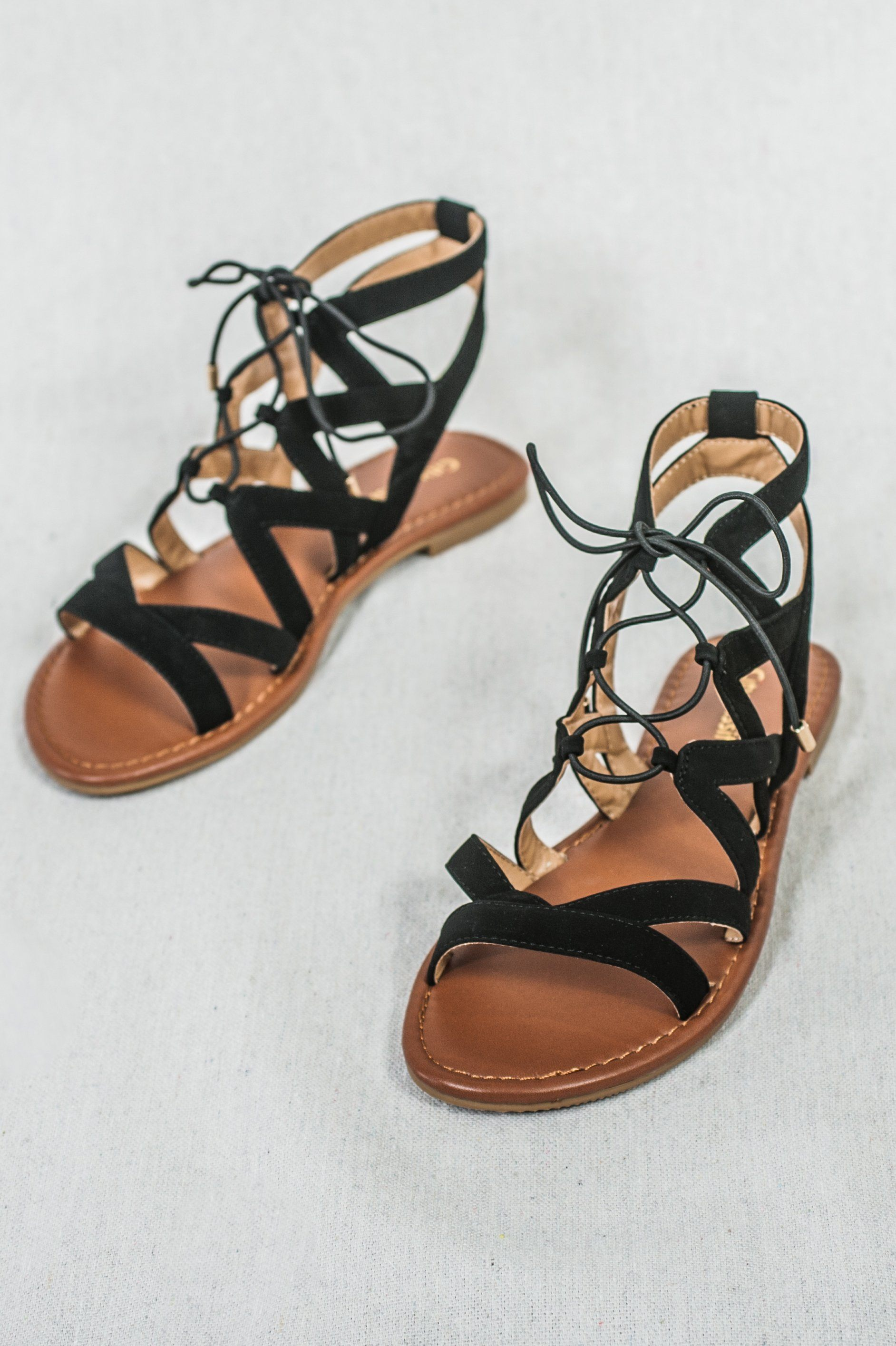 cross strapped faux suede gladiator sandals with lace-up front